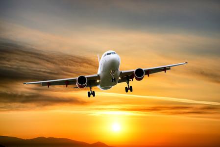 Airplane flying at sunrise 00814