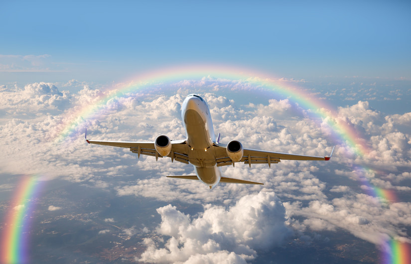 Passenger airplane in rainbow 00954