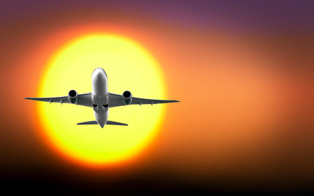Passenger plane with the sun 00948