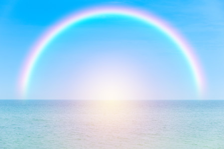 Rainbow over tropical sea background 00373