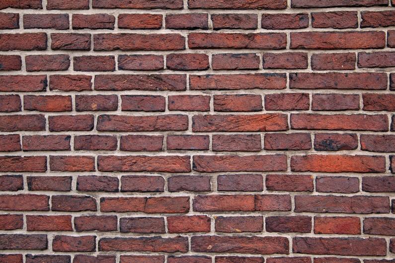 Wall of red bricks 00093